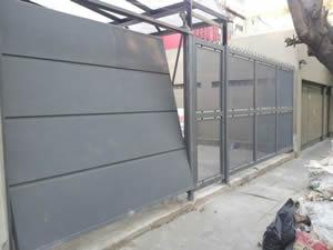 portones automaticos levadizos con puerta de escape